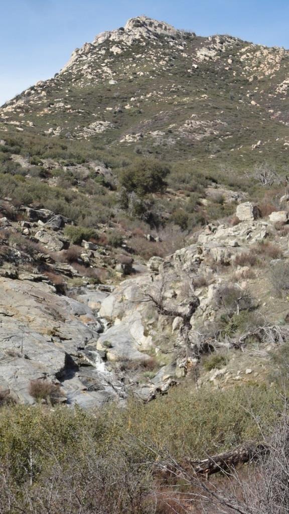 water cascades through the rocks below stonewall peak